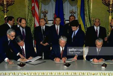 Translating for Presidents Yeltsin, Clinton and Kuchma at the signing of the treaty on the denuclearisation of Ukraine, Moscow 1994 (also in picture Russian Prime Minister Viktor Chernomyrdin, Foreign Minister Andrei Kozyrev, Defence Minister Pavel Grachev, US Secretary of State Warren Christopher)
