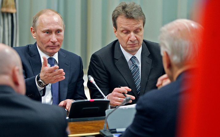 Vice President of the United States Joe Biden, right with back to camera, listens to Russian Prime Minister Vladimir Putin, left, in Moscow, Russia, Thursday, March 10, 2011.  AP